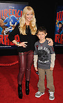 HOLLYWOOD, CA - OCTOBER 29: Charlotte Ross and Max arrive at the Los Angeles premiere of 'Wreck-It Ralph' at the El Capitan Theatre on October 29, 2012 in Hollywood, California.