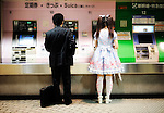 Commuters buy tickets at an underground station in Tokyo, Japan.