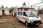 21 May 2013, Mandiganal Village, Karnartaka, India:  The mobile health clinic ambulance at Mandiganal Village outside Hubli. The World Bank is financing the Karnataka Health Systems Project that is bringing mobile health clinics to remote villages in Karnataka and covers the cost of an ambulance, a doctor, pharmacist, two nurses, a cleaner and a driver. Villagers have the opportunity to see a doctor once a week for basic services and will be referred to Primary Health Care centres for larger issues Picture by Graham Crouch/World Bank