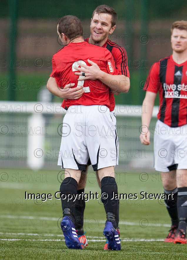 Gala's Ross Aitchison (7) is congratulated by Lee Stephen (2) after he scores their first goal.