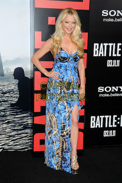 """CHARLOTTE ROSS.Premiere of """"Battle: Los Angeles"""" held at The Grauman's Chinese Theatre in Hollywood, California, USA..March 8th, 2011 .full length blue maxi dress black print hand on hip yellow slit split gold platform shoes sandals .CAP/ADM/BP.©Byron Purvis/AdMedia/Capital Pictures."""