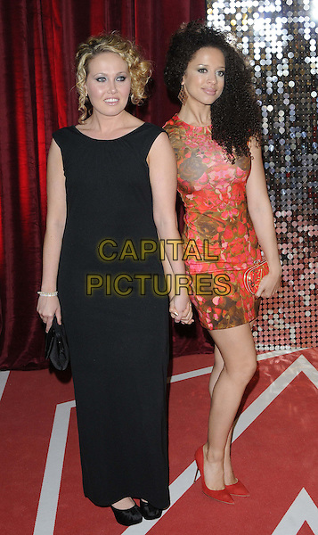 Rebecca Atkinson & Natalie Gumede.attended the British Soap Awards 2013, Media City, Salford, Manchester, England, UK, 18th May 2013..arrivals full length red floral print dress black holding hands  shoes  sleeveless long maxi .CAP/CAN.©Can Nguyen/Capital Pictures.