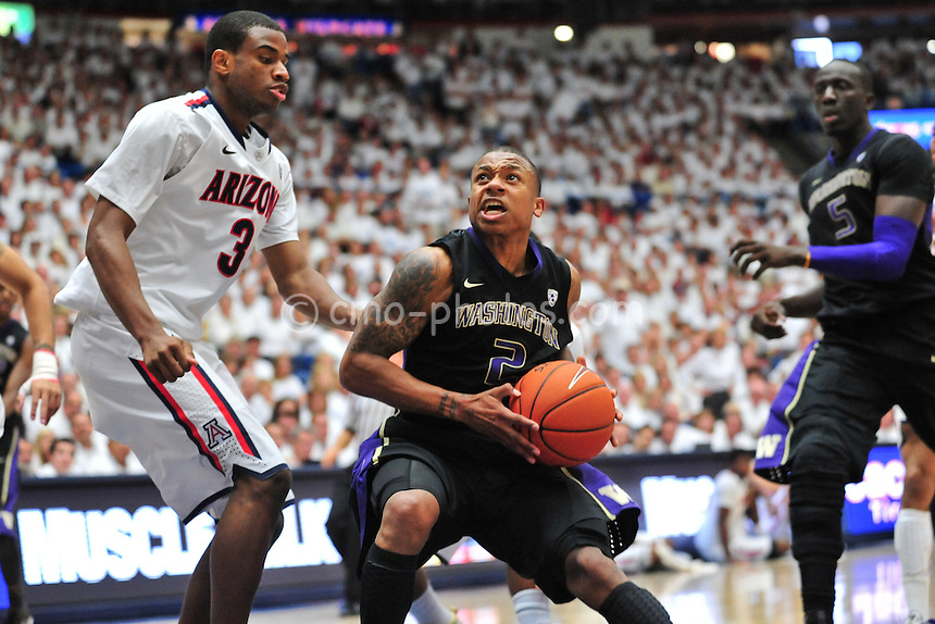 Feb 19, 2011; Tucson, AZ, USA; Washington Huskies guard Isaiah Thomas (2) picks up his dribble while Arizona Wildcats forward Kevin Parrom (3) defends in the 2nd half of a game at the McKale Center.  The Wildcats won 87-86.