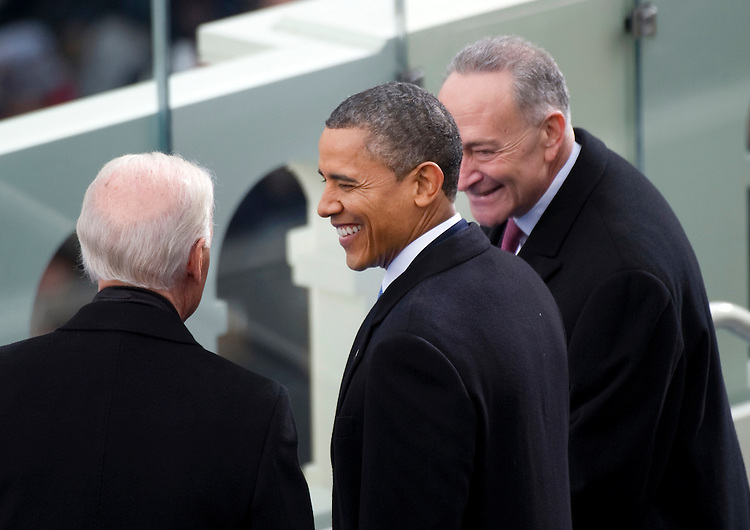 UNITED STATES - JANUARY 21:  Vice President Joe Biden,  President Barack Obama, and Sen. Chuck Schumer, D-N.Y, at the inauguration for his second term of office. More than 600,000 people attended the event. (Photo By Chris Maddaloni/CQ Roll Call)