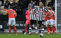 Christian Walton of Luton Town celebrates after pushing Vadaine Olivers penalty away during the Sky Bet League 2 match between Notts County and Luton Town at Meadow Lane, Nottingham, England on 29 October 2016. Photo by Liam Smith / PRiME Media