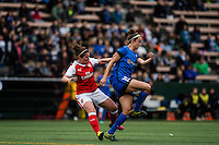 Seattle, WA - Thursday, May 26, 2016: Seattle Reign FC midfielder Havana Solaun (19) and Emma Mitchell (3) of Arsenal Ladies FC. The Seattle Reign FC of the National Women's Soccer League (NWSL) and the Arsenal Ladies FC of the Women's Super League (FA WSL) played to a 1-1 tie during an international friendly at Memorial Stadium.
