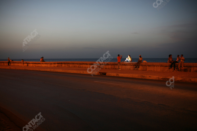 ©2008 David Burnett / Contact Press Images..July 9 2008..Havana, Cuba.The Malecon at sunset