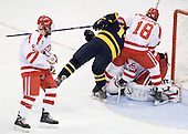 David Warsofsky (BU - 5), Joe Cucci (Merrimack - 14), Wade Megan (BU - 18), Grant Rollheiser (BU - 35) - The Boston University Terriers defeated the Merrimack College Warriors 6-4 (EN) on Saturday, January 16, 2010, at Agganis Arena in Boston, Massachusetts.
