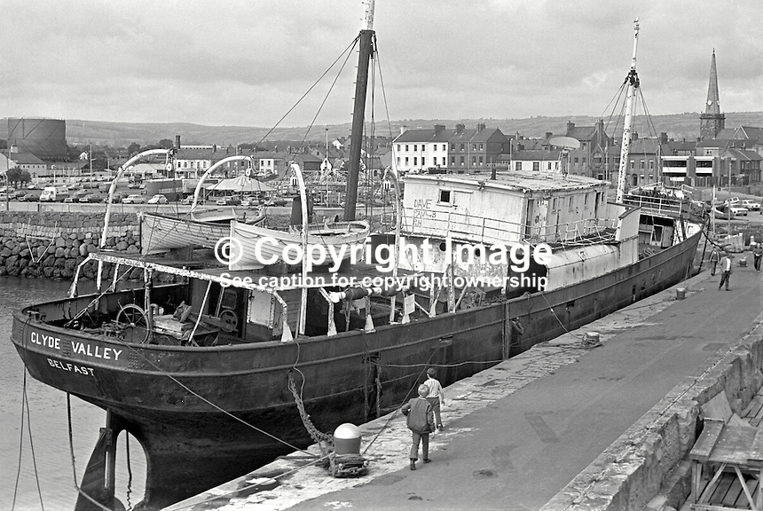 Clyde Valley, the former UVF gun-running ship, which is to be towed to a breaker's yard in England, UK. It is seen berthed in the Harbour at Carrickfergus, Co Antrim, N Ireland. 197407300414b.<br />