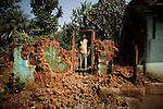 Indian Christian man returns to his house damaged during the riots run by hardline Hindu activists in Orissa's Kandhamal district, some 350 kms southwest of Bhubaneswar. Nov. 6, 2008. .