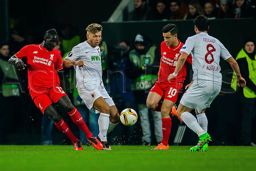 18.02.2016. Augsburg, Germany. UEFA Europa League football. Augsburg versus Liverpool FC.  Mamadou Sakho (FC Liverpool 17) Alexander Esswein (FC Augsburg 11) Coutinho (FC Liverpool 10) Markus Feulner (FC Augsburg 8)