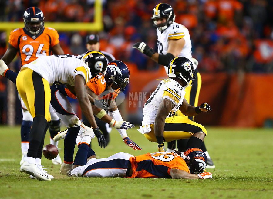 Jan 17, 2016; Denver, CO, USA; Pittsburgh Steelers running back Fitzgerald Toussaint (33) fumbles the ball against the Denver Broncos during the fourth quarter of the AFC Divisional round playoff game at Sports Authority Field at Mile High. Mandatory Credit: Mark J. Rebilas-USA TODAY Sports