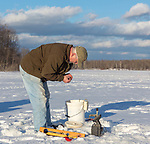 Ice fisherman preparing his bait.