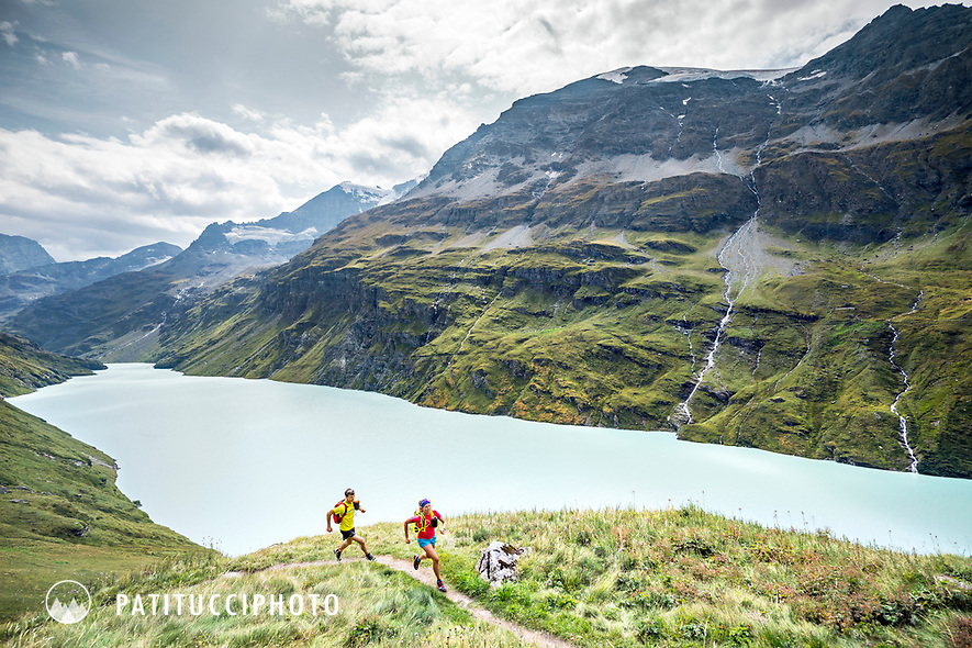 The Chamonix to Zermatt Glacier Haute Route. In late August 2017, we ran the tour in mountain running gear, running shoes, and all the necessary glacier travel and crevasse rescue gear. Running above the Lac de Mauvoisin on the way to the Chanrion Hut.