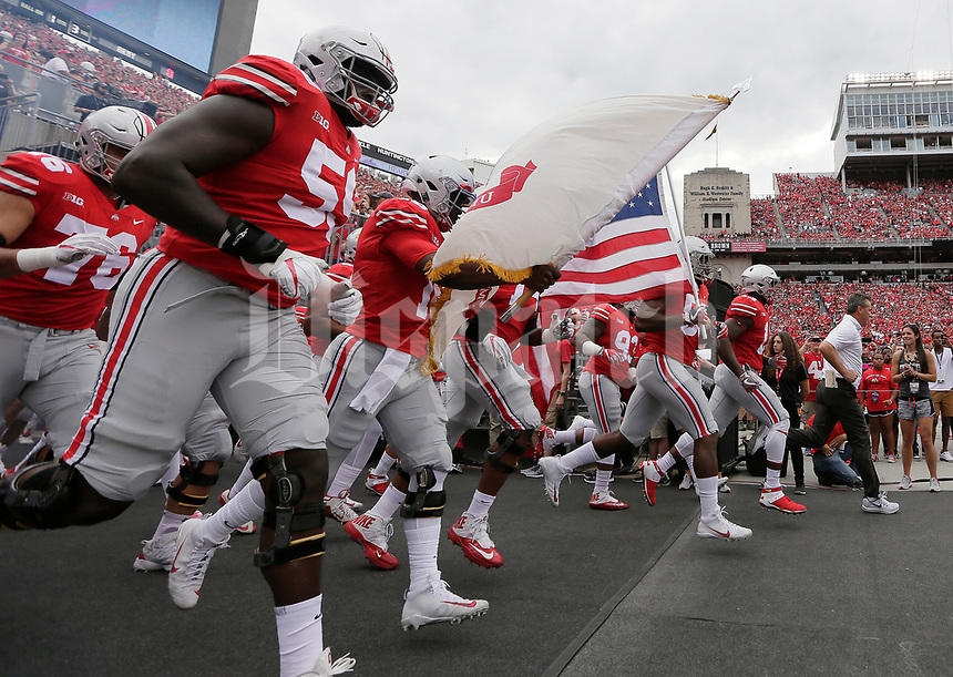 The Ohio State Buckeyes take the field prior to the NCAA football game against the Army Black Knights at Ohio Stadium in Columbus on Sept. 16, 2017. [Adam Cairns / Dispatch]