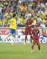 Brazil forward Alexandre Pato (9) and Portugal midfielder Vieirinha (11) compete for a head ball.  In an International friendly match Brazil defeated Portugal, 3-1, at Gillette Stadium on Sep 10, 2013.