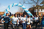 Students and community members walk and run past the starting line at the first annual Wellness Revolution 5K Run and Walk on the Spelman College campus in Atlanta, Georgia April 6, 2013.