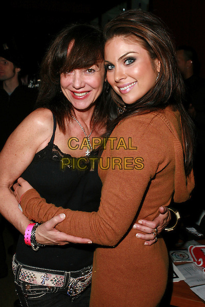 "MELISSA PROPHET & NADIA BJORLIN.Redline Premiere Party, ""Myspace For Myfriends"" held at Aura Nightclub, Studio City, California, USA.  .April 18th, 2007.half length brown dress hug embrace .CAP/ADM/CH.©Charles Harris/AdMedia/Capital Pictures"