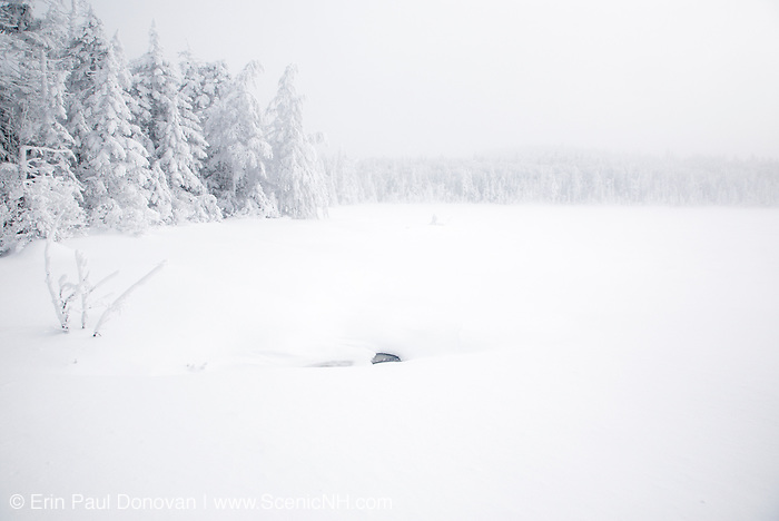 Franconia Notch State Park - Lonesome Lake during the winter months in the White Mountains, New Hampshire USA in whiteout conditions