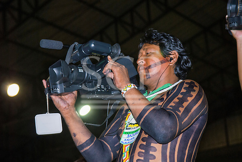 Altamira, Brazil. Encontro Xingu protest meeting about the proposed Belo Monte hydroeletric dam and other dams on the Xingu river and its tributaries. Bajkare Kayapo, a cameraman, with his panasonic camera.