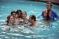 Los Angeles, CA, Summer 1982. The Osterman Weekend is a 1983 suspense thriller film directed by Sam Peckinpah. The film stars Rutger Hauer, John Hurt, Burt Lancaster, Dennis Hopper, Meg Foster and Craig T. Nelson. It was Peckinpah's final film before his death in 1984. Swiming pool scene.