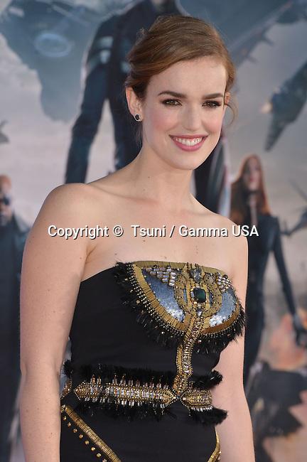 Elizabeth Henstridge 203 arriving at the Captain America Premiere at the El Capitan Theatre in Los Angeles.