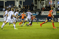 Pelly Ruddock of Luton Town (centre) is fouled inside the Newport County penalty box by Jamie Turley of Newport County (5) for Luton Town's second penalty during the Sky Bet League 2 match between Luton Town and Newport County at Kenilworth Road, Luton, England on 16 August 2016. Photo by David Horn.