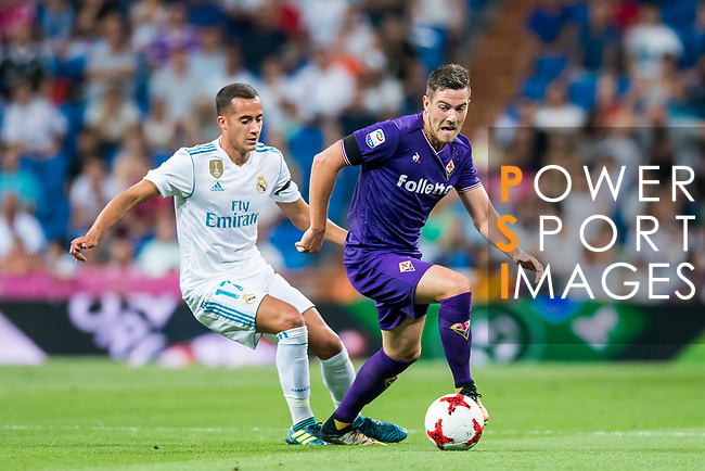 Jordan Veretout (r) of ACF Fiorentina competes for the ball with Lucas Vazquez of Real Madrid during the Santiago Bernabeu Trophy 2017 match between Real Madrid and ACF Fiorentina at the Santiago Bernabeu Stadium on 23 August 2017 in Madrid, Spain. Photo by Diego Gonzalez / Power Sport Images
