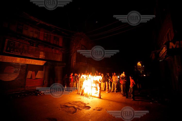 Police clash with stone throwing youth following the arrest of separatist leader Muhammad Yaseen Malik. Srinagar, Kashmir, India. © Fredrik Naumann/Felix Features