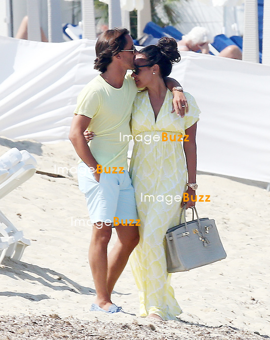 """TAMARA ECCLESTONE & JAY RUTLAND ON HONEYMOON IN SAINT TROPEZ - June 15, 2013-Tamara Ecclestone and new husband Jay Ruttland enjoying their honeymoon in Saint-Tropez, France.Following a romantic lunch lunch at """" Les Palmiers """" restaurant, the newly wed couple walked on the famous beach of Pampelonne before heading back on board their luxurious $370,000 'Silver Angel' yacht per week."""