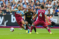 Ryan Fredericks of West Ham United, Raheem Sterling of Manchester City and Fabian Balbuena of West Ham United during the Premier League match between West Ham United and Manchester City at the London Stadium, London, England on 10 August 2019. Photo by David Horn.