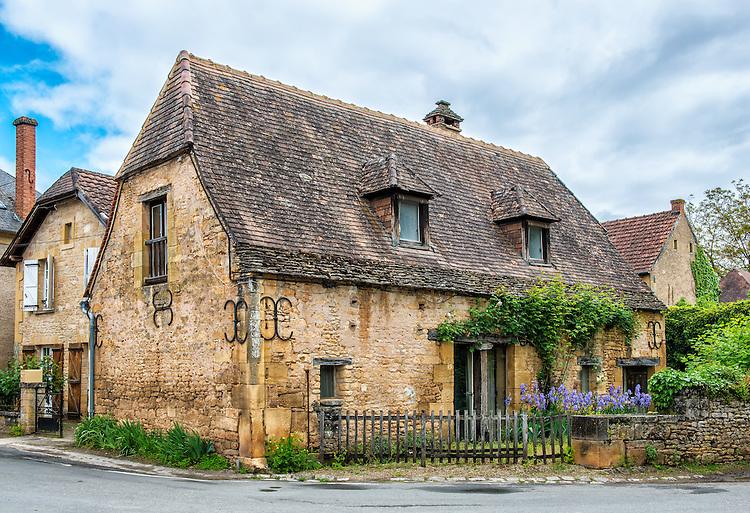 """An ancient house in Saint-Léon-sur-Vézère. Saint-Léon-sur-Vézère is classified as one of """"Les Plus Beaux Villages de France."""""""