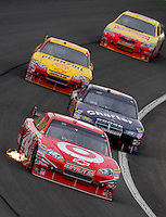 Feb 22, 2009; Fontana, CA, USA; NASCAR Sprint Cup Series driver Juan Pablo Montoya leads a pack of cars during the Auto Club 500 at Auto Club Speedway. Mandatory Credit: Mark J. Rebilas-