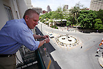 Television and radio host Glenn Beck looks over the balcony of his hotel room onto Alamo Plaza, Wednesday, April 15, 2009, in San Antonio. (Darren Abate/pressphotointl.com)