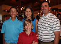 NWA Democrat-Gazette/CARIN SCHOPPMEYER James and Angie Graves (from right) are joined by their sons Henry Graves and Charlie Graves at Red, White and Baby Blue on June 28 at The Garden Room in Fayetteville.