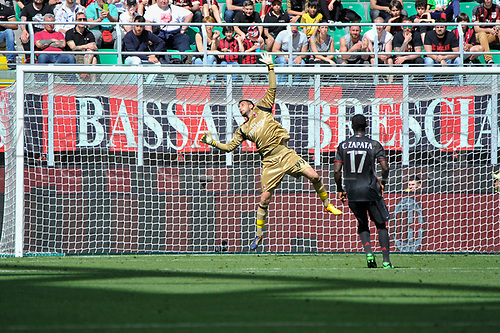 April 23rd 2017, San Siro Stadium, Milan, Italy; Goalkeeper Gianluigi Donnarumma of Milan tips a shot over his crossbar during Serie A football AC Milan versus Empoli;