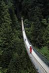 Tourists walking on Capilano suspension bridge North Vancouver British Columbia Canada
