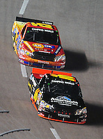 Nov. 6, 2009; Fort Worth, TX, USA; NASCAR Camping World Truck Series driver Brian Scott leads Aric Almirola during the WinStar World Casino 350 at the Texas Motor Speedway. Mandatory Credit: Mark J. Rebilas-