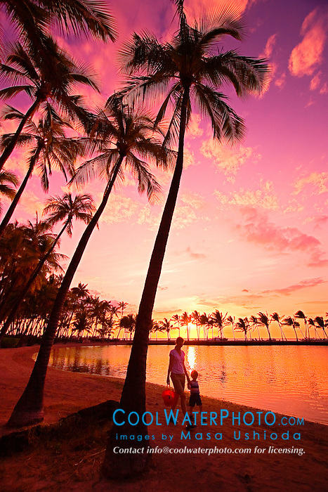 Mother and child walking, `Anaeho`omalu Beach at sunset, Waikoloa, Big Island, Hawaii, Pacific Ocean