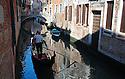 Gondola along canal in Venice, Italy