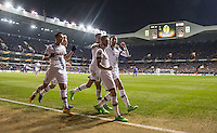 Ryan Mason (2nd right) of Tottenham Hotspur celebrates his goal with teammates during the UEFA Europa League 2nd leg match between Tottenham Hotspur and Fiorentina at White Hart Lane, London, England on 25 February 2016. Photo by Andy Rowland / Prime Media images.
