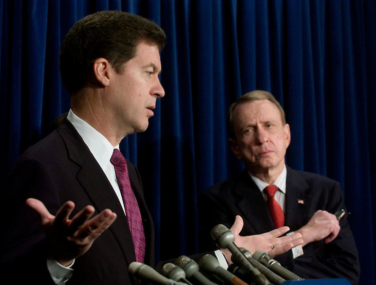 01/24/06.ALITO NOMINATION--Sen. Sam Brownback, R-Kan., and Chairman Arlen Specter, R-Pa., during a news conference after the Senate Judiciary Committee voted 10-8 along party lines Tuesday to approve the nomination of Samuel A. Alito Jr. to the Supreme Court. The full Senate will take up the nomination Wednesday; a close confirmation vote is expected within the next several days..CONGRESSIONAL QUARTERLY PHOTO BY SCOTT J. FERRELL