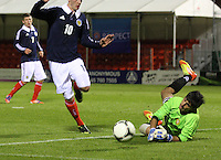 Gregor Harutyunyan saves from John Herron in the Scotland v Armenia UEFA European Under-19 Championship Qualifying Round match at New Douglas Park, Hamilton on 9.10.12.