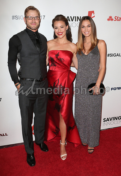 30 September 2017 - Los Angeles, California - Kellan Lutz, Kim Biddle, Brittany Gonzales. 6th Annual Saving Innocence Gala held at Loews Hollywood Hotel. Photo Credit: F. Sadou/AdMedia