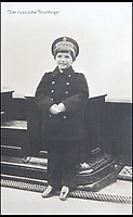 BNPS.co.uk (01202 558833)<br /> Pic: HAldridge/BNPS<br /> <br /> The Tsarevich Alexei onboard The Royal Yacht, the Standart.<br /> <br /> Poignant photographs of the last Russian royal family visiting their British relatives - the King and Queen of Britain - have come to light.<br /> <br /> The black and white images show Tsar Nicholas II, his wife Alexander and their children at Osborne House on the Isle of Wight in 1909 with Edward VII and his wife, Mary of Teck.<br /> <br /> The images show just how close the two Royal families were. <br /> <br /> The album of up to 100 photo postcards is being sold for &pound;1,500 by Henry Aldridge and Son.