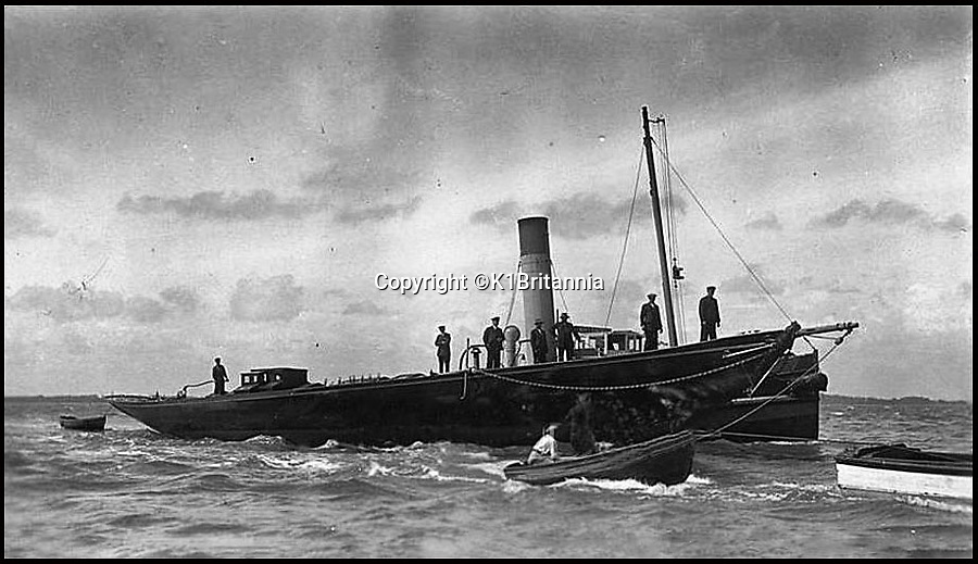 BNPS.co.uk (01202 558833)<br /> Pic: K1Britannia/BNPS<br /> <br /> ***Please Use Full Byline***<br /> <br /> The Britannia's 'last' voyage on July 9th 1936  around to St Catherine's. The Britannia being towed by the H.M.S. Winchester to be sunk in the sea.<br /> <br /> An 8 million pounds appeal has been launched to resurrect one of the most famous and best loved racing yachts of all time - the 'King's yacht' Britannia.<br /> <br /> The historic 177ft yacht was built for playboy prince Albert in 1893 and became an instant star of the sailing scene, winning 33 of 43 prestigious races  in her first year alone.<br /> <br /> The stunning Royal yacht became known the world over and enjoyed an illustrious racing career at the hands of Albert, who went on to become King Edward VII.<br /> <br /> Edward's son George V continued the love affair with Britannia, dubbed 'the King's yacht', so much so that on his death in 1936 she was deliberately sunk off the Isle of Wight.<br /> <br /> Now, 78 years on, campaigners are nearing the final stages of a project to complete an an inch-perfect replica of Britannia which has been 20 years in the making.<br /> <br /> The instantly recognisable hull is finished but around six million pounds is needed to transform it into a yacht worthy of Royalty. <br /> <br /> The yacht, which will cost an extra one million pounds a year to run, will then be taken all round the world so it can be enjoyed by charities and future generations.
