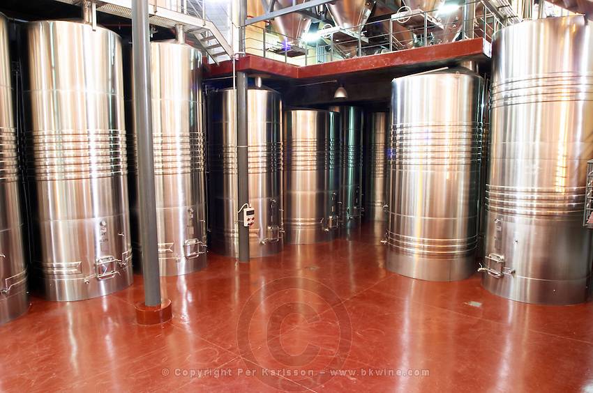The winery with many big stainless steel fermentation tanks. Bodega Familia Schroeder Winery, also called Saurus, Neuquen, Patagonia, Argentina, South America