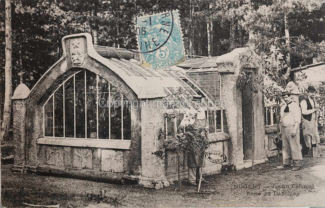 Dahomey Greenhouse, used to display plants from India, China or America, such as coffee, tea, rubber, cocoa and benzoin, which were acclimatised and destined to settle in another colony, in the Dahomey (now Benin) enclosure of the Colonial Exhibition of 1907, which was held in the Jardin d'Agronomie Tropicale, or Garden of Tropical Agronomy, in the Bois de Vincennes in the 12th arrondissement of Paris, postcard from the nearby Musee de Nogent sur Marne, France. The garden was first established in 1899 to conduct agronomical experiments on plants of French colonies. In 1907 it was the site of the Colonial Exhibition and many pavilions were built or relocated here. The garden has since become neglected and many structures overgrown, damaged or destroyed, with most of the tropical vegetation disappeared. The site is listed as a historic monument. Picture by Manuel Cohen / Musee de Nogent sur Marne