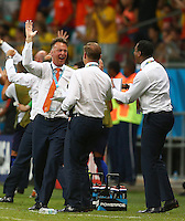 Netherlands manager Louis Van Gaal celebrates his sides third goal, 1-3