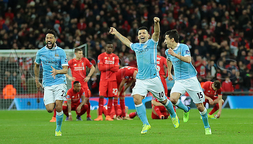 28.02.2016. Wembley Stadium, London, England. Capital One Cup Final. Manchester City versus Liverpool. Manchester City's Sergio Agüero,  Jesús Navas and Gaël Clichy celebrate Yaya Touré scoring his penalty and winning the shoot out and cuo for Manchester City